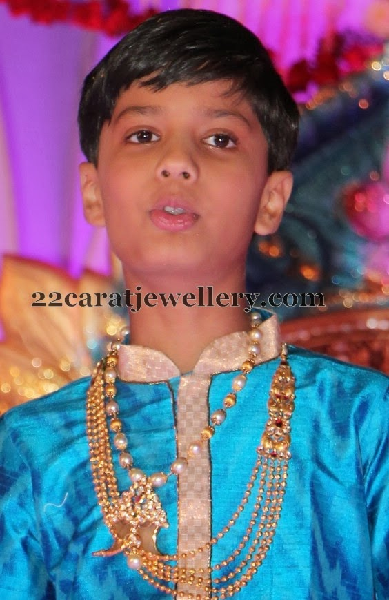 Boy In South Pearl Set With Puligoru Jewellery Designs