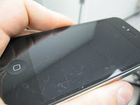iPhone with scratches on the screen
