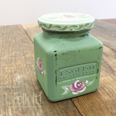 Old jars decorated with paint and folk art roses and designs