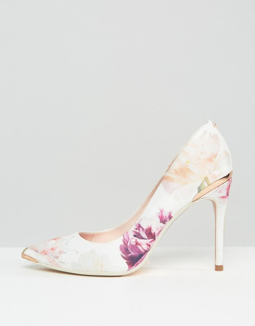 http://www.asos.com/ted-baker/ted-baker-kawaap-sketchbook-satin-court-shoes/prd/7607893?affid=10607&transaction_id=1024df5783aab2f6a5a78f670d9373&pubref=1023