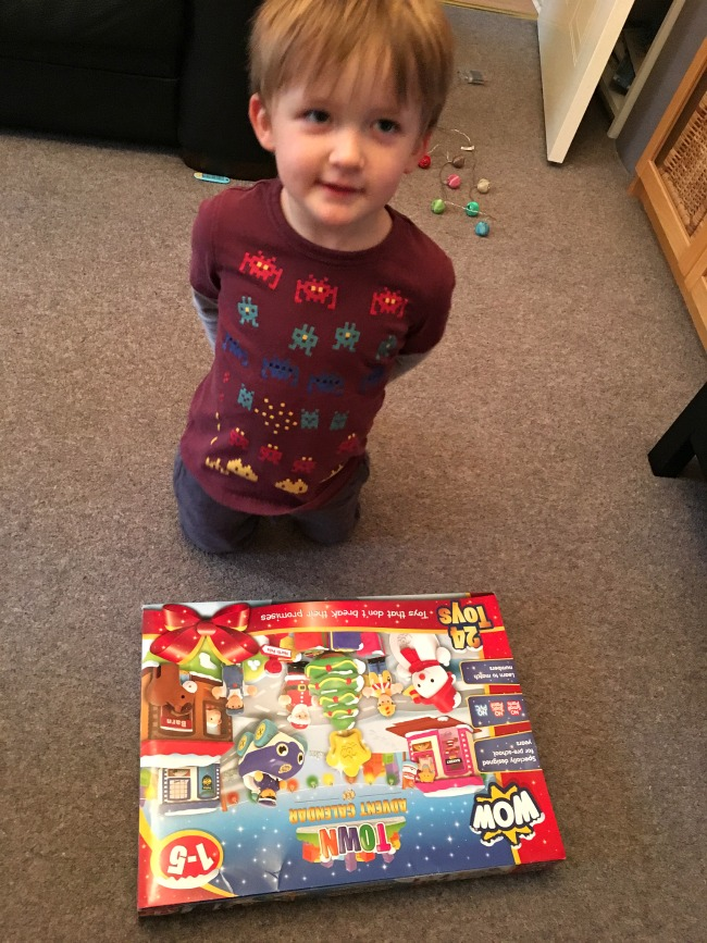 toddler-with-unopened-box-wow-toys-town-advent-calendar