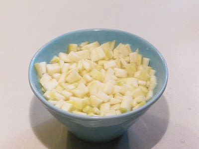 chopped apples in a bowl of lemon water