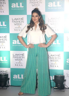 Zareen Khan sizzles in White Shirt and Green trousers