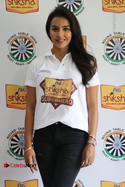 Actress Priya Anand Stills in Ripped Balck Jeans at Shiksha Movement Event .COM 0008.jpg