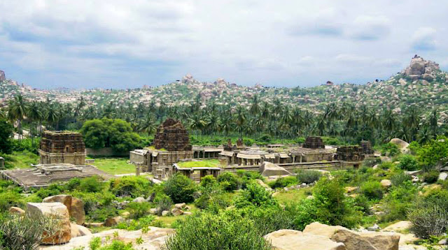 A view of the Achyutaraya Temple in Hampi, nestled between the hills and forests.