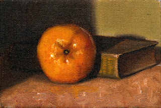Oil painting of a mandarine beside an old green linen-bound book.