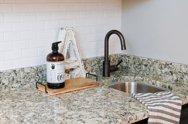 A basement bar area gets a makeover with a beautiful mosaic subway tile backsplash. - Littlehouseoffour.com
