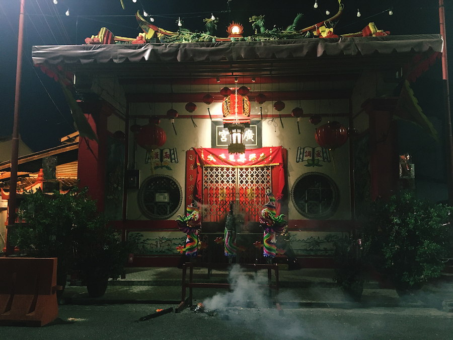 A chinese temple performing a ceremony at night in Malacca