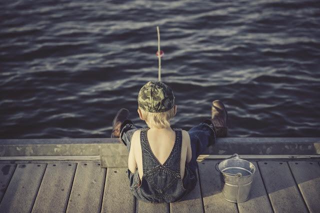 kids fishing at the sea