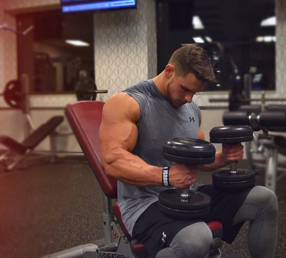 strong-gym-hunks-big-bicep-lifting-weights
