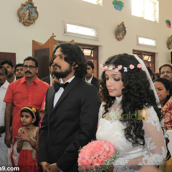 Actress Ann Augustine wedding photos with Jomon T John