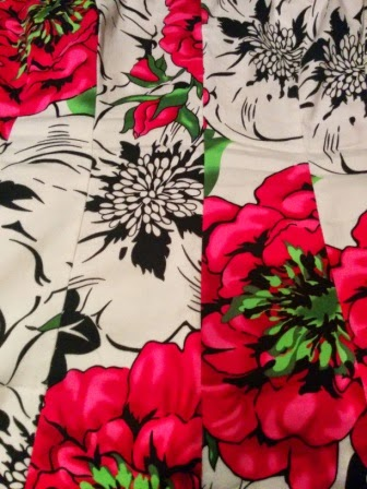 Fabric with some large pink flowers and some large uncolored flowers