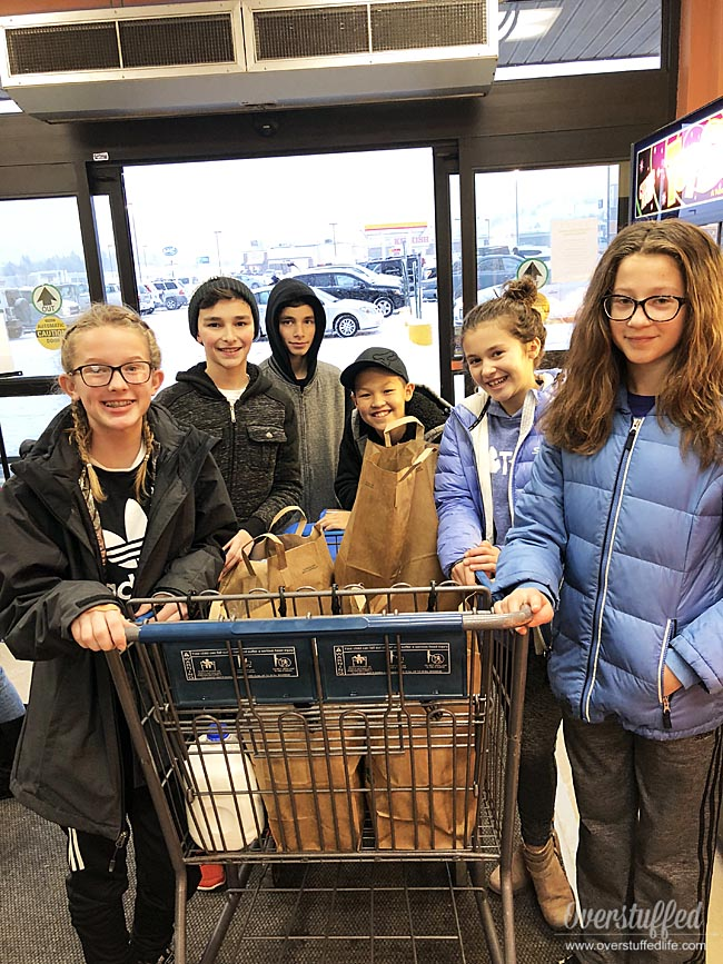 These 6th graders helped a family in need at Christmas by buying them groceries.