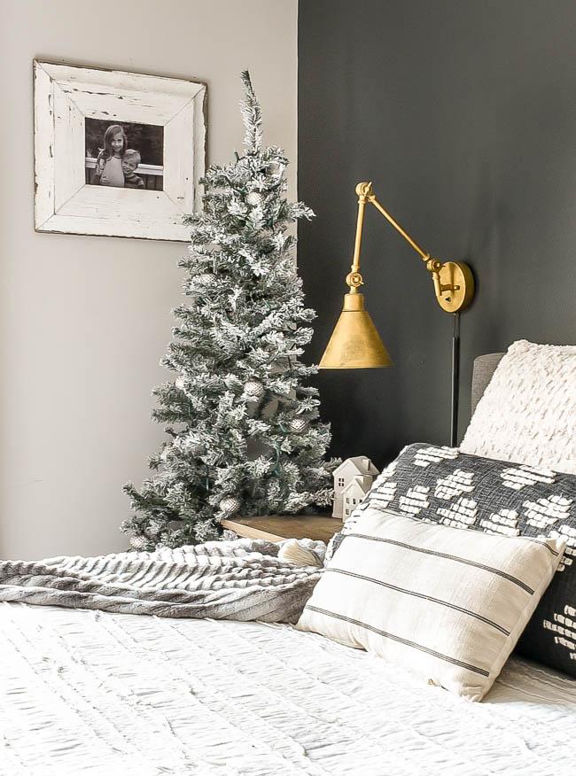 Flocked Christmas tree in bedroom