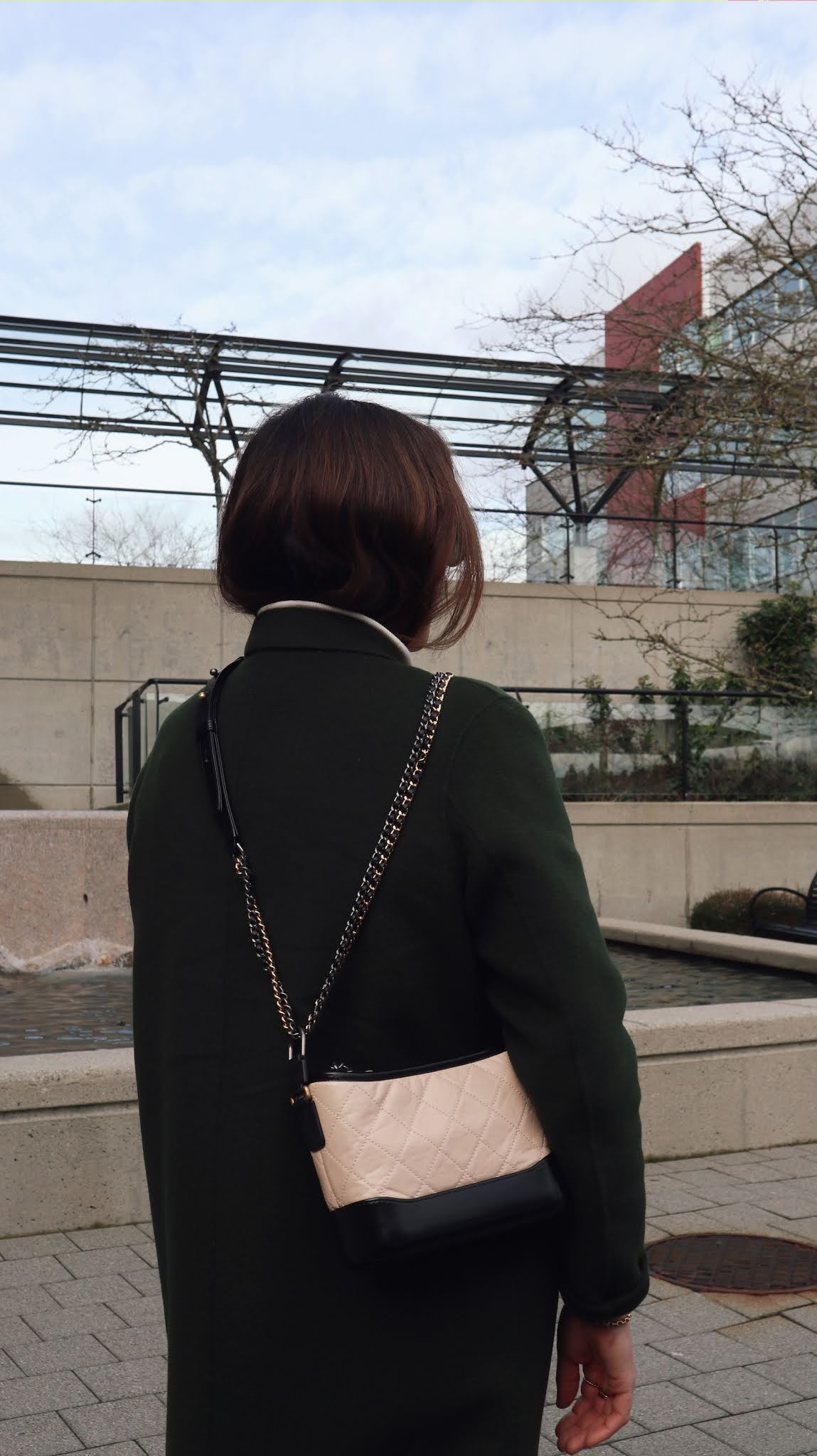green wool jacket outfit winter allbirds chanel gabrielle bag