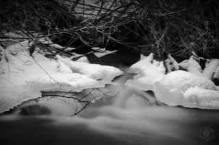 Cramer Imaging's professional black and white landscape photograph of a snowy icy stream at Cherry Springs Nature Area, Caribou National Forest, near Pocatello, Bannock, Idaho