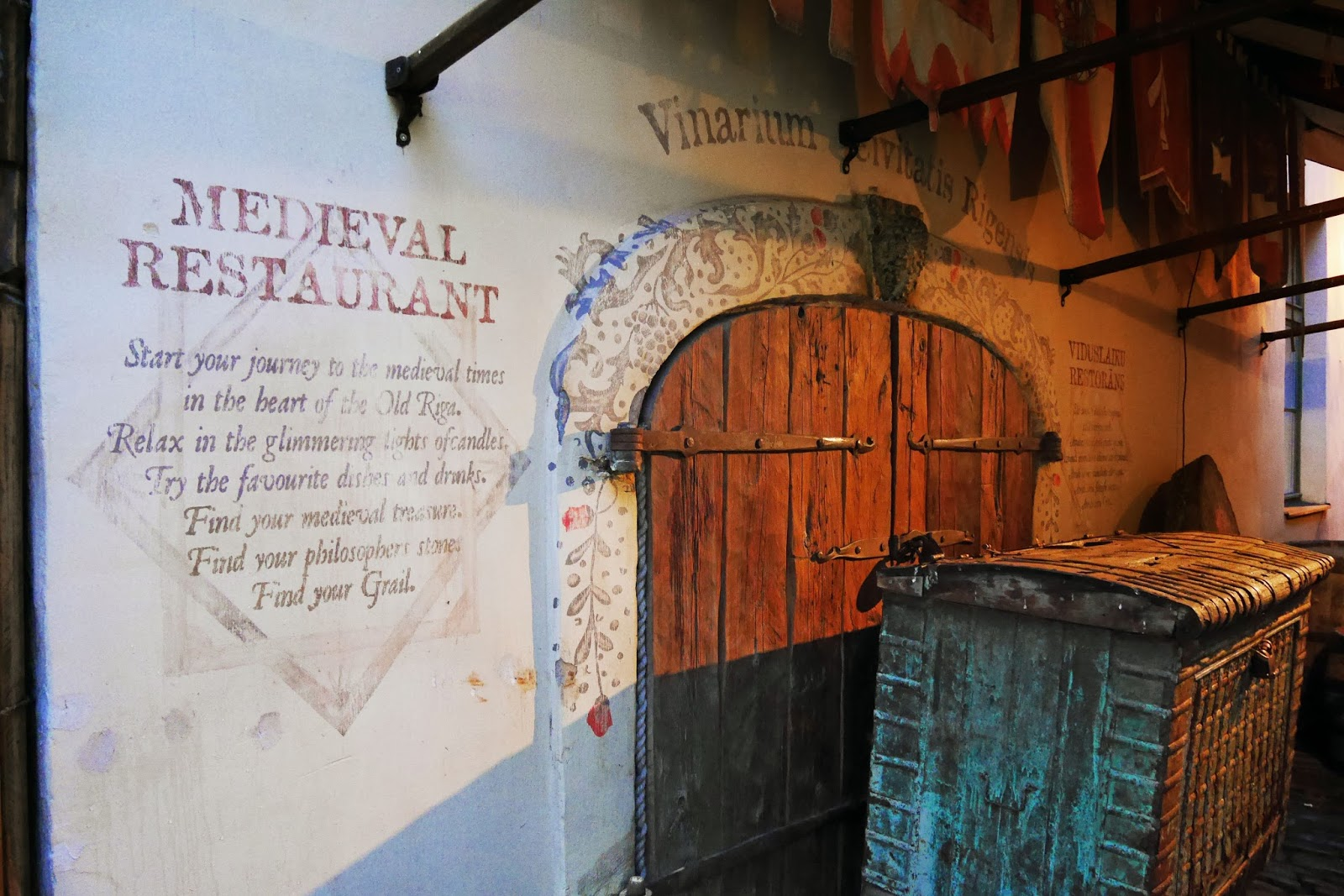Medieval decor and signage outside Rozengrāls Medieval Restaurant in Riga, Latvia