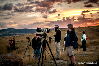 Cramer Imaging's photograph of photographers with cameras waiting for a landscape shot with a sunset behind in Tetonia, Idaho