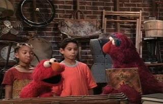 Elmo, Telly and two children find a magic cookbook. They call Jean the Genie. Sesame Street Elmo's Magic Cookbook