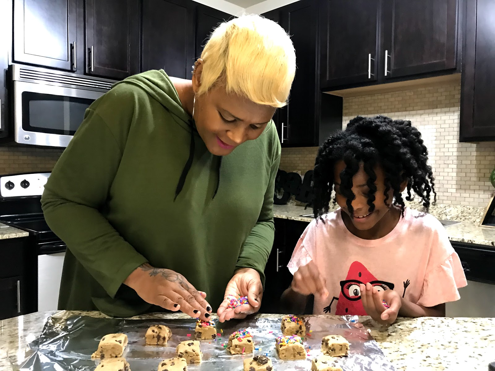 Image: Tangie Bell and Daughter Moriah decorating cookies. For the joyful list on Bits and babbles