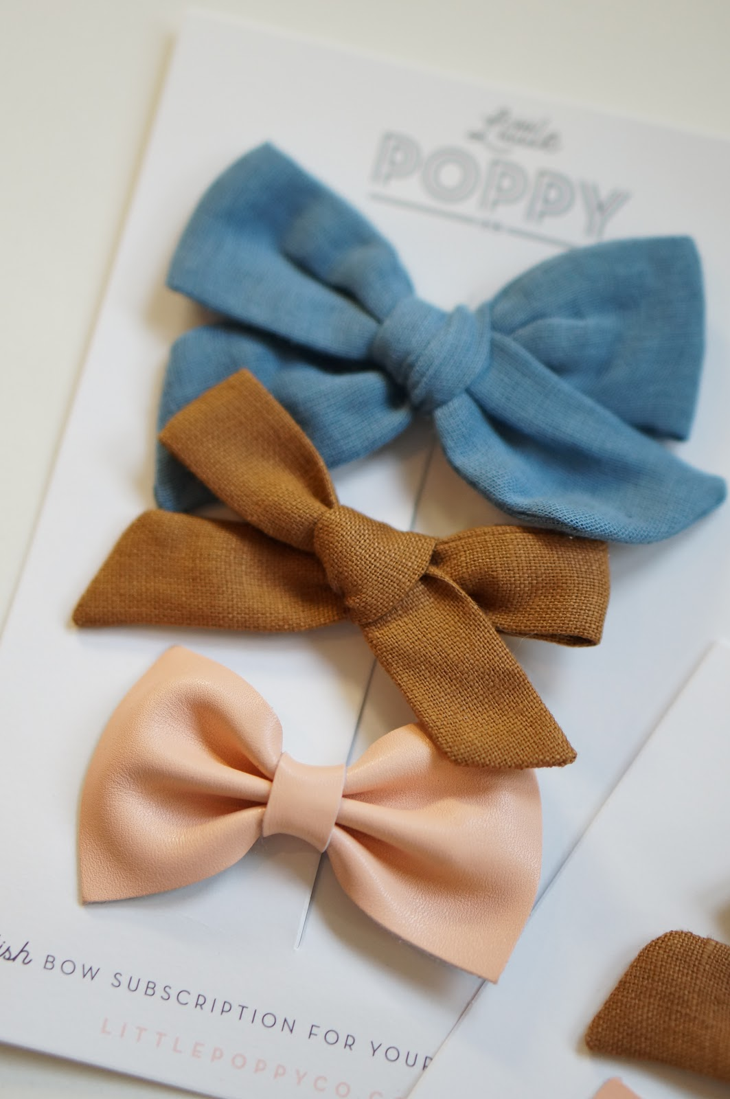 North Carolina style blogger Rebecca Lately shares Little Poppy Co bows for January. Read more here!