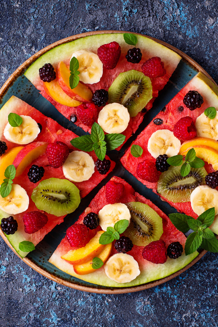Fruit Pizza Recipe - The BEST Summer dessert that's topped with fresh fruit and has a soft sugar cookie crust. Super simple to make and always a hit. You'll absolutely love this easy fruit pizza! #fruit #fruitpizza #sugarcookies #sugarcookierecipe #creamcheesefrosting #baking #summer #summerrecipes #fruity #easydesserts #desserts #dessertrecipes #recipes #iheartnaptime