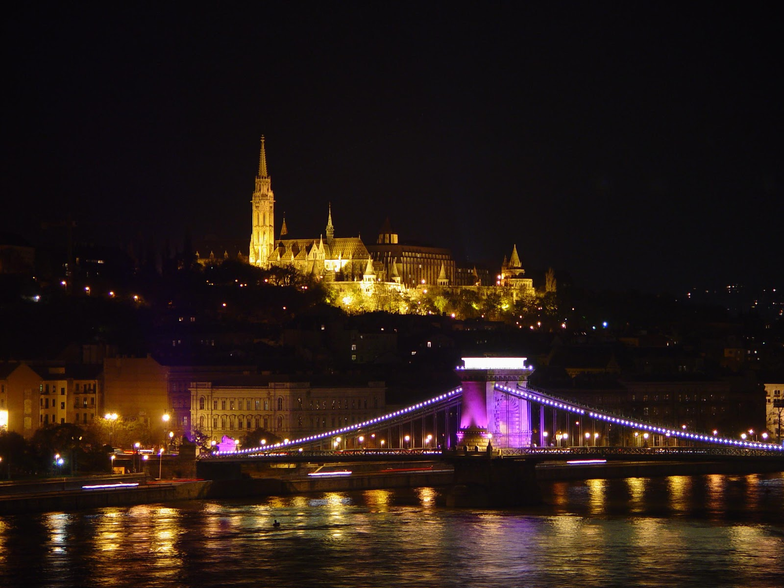 Cruising into Budapest, Hungary, by night revealed a contrasting panorama of gold against the darkness of night. This photo only: WikiMedia.org.
