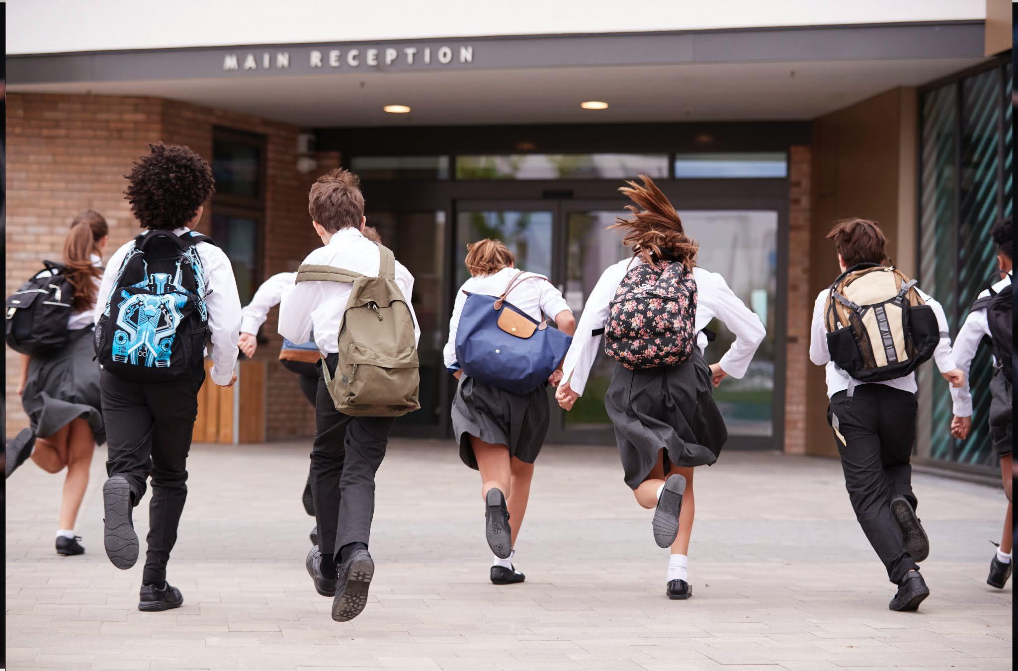 children running in to school