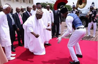 Obasanjo dancing with young man