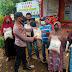 Kapolsek Marbo Bagikan Beras Bantuan Polri Kepada Warga Miskin