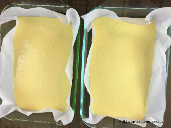 Divide the cake batter between two baking pans from Walking on Sunshine