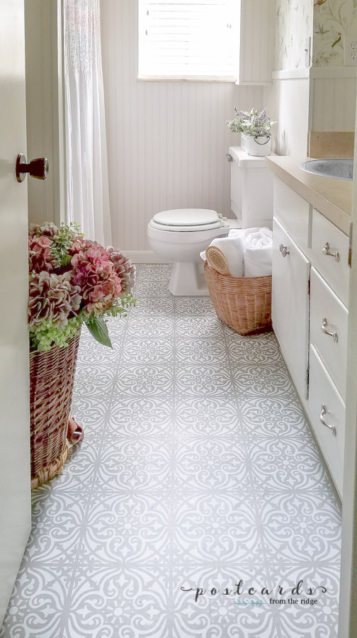stenciled tile floor in bathroom