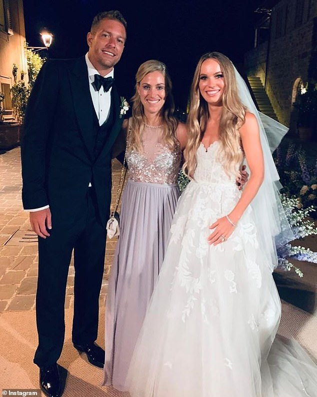 Caroline Wozniacki looked beautiful in an ethereal Oscar de la Renta wedding gown as she tied the knot with her husband, former NBA star David Lee