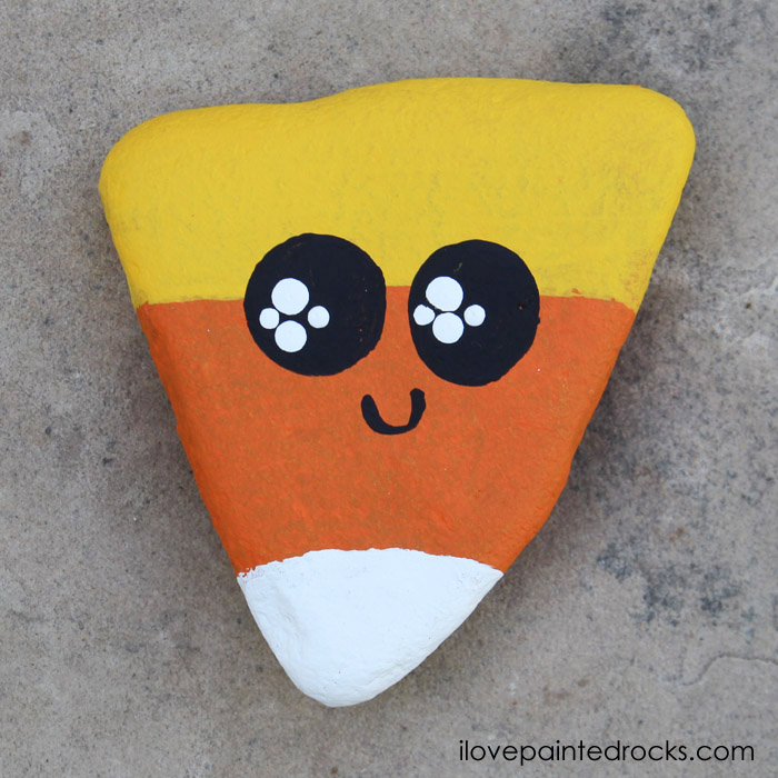 Kawaii candy corn painted rock tutorial diy is the perfect fall craft for kids, rock painting enthusiasts or beginners.