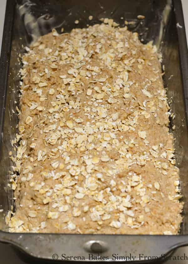 Irish Brown Bread dough in bread pan sprinkled with quick oats from Serena Bakes Simply From Scratch.