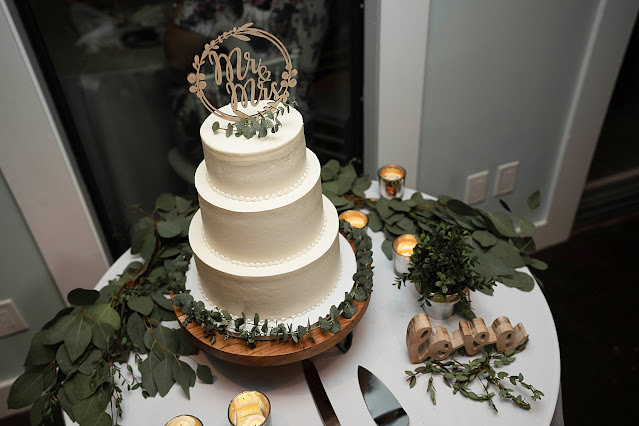 Detail shot of Wedding Cake with Mr and Mrs cake topper The Manor on St Lucie Crescent Wedding captured by Stuart Wedding Photographer Heather Houghton Photography