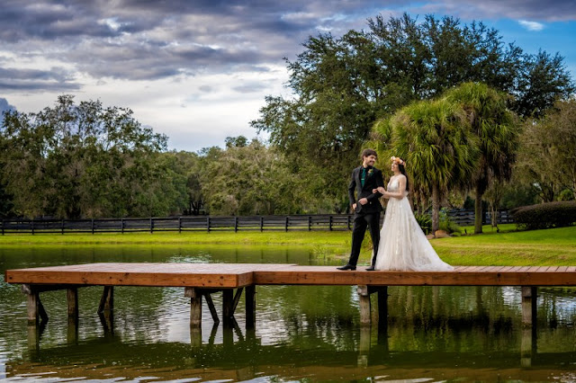 bride and groom on lake dock