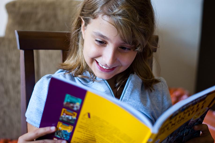 NAMC montessori focusing on desired behavior friendship theme classroom happy girl reading