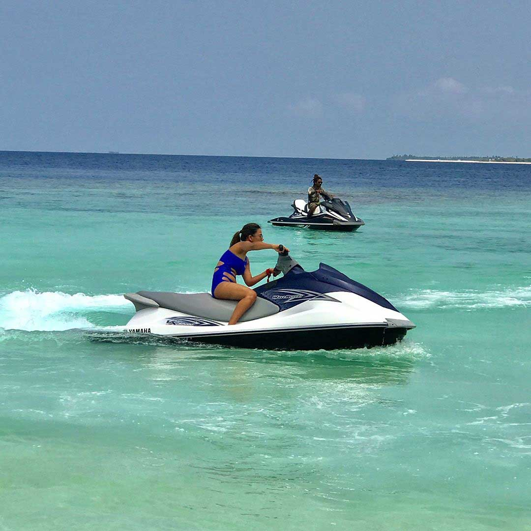 Nia Sharma Hot and Sexy in Blue Bikini Swimauit jetski