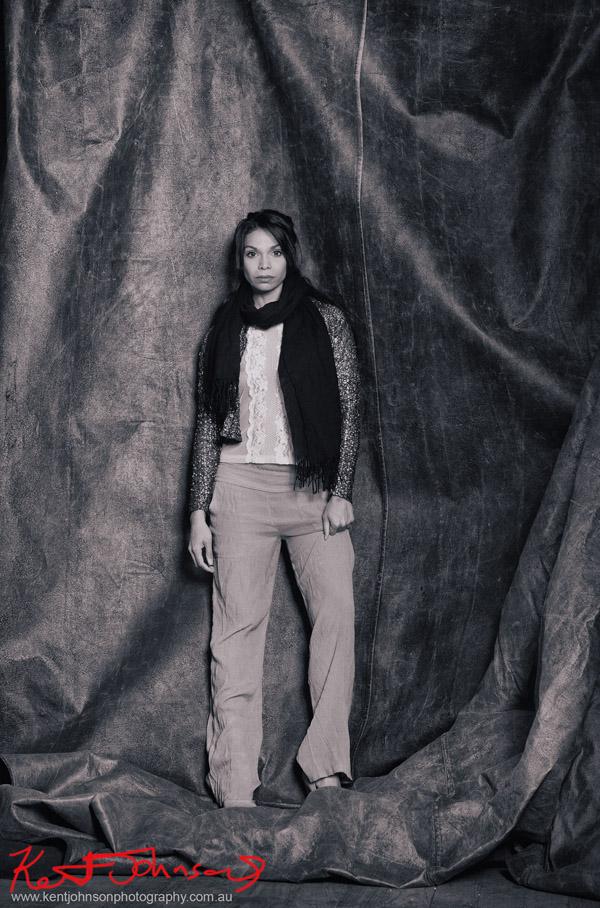 Sage Godrei, magazine style actors portrait; studio photography, black background, Sage full length black and white shot.