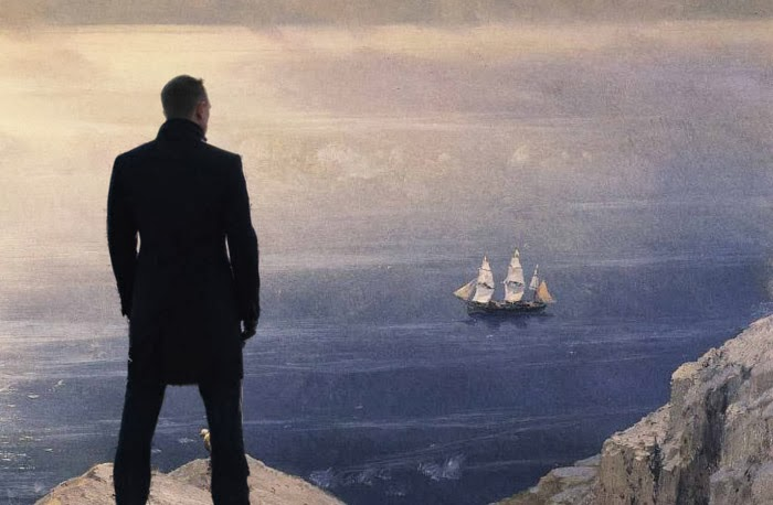 Bond standing on a coast with a sailing ship