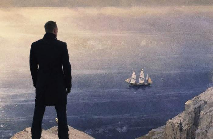 Bond standing on a coast with a sailing ship