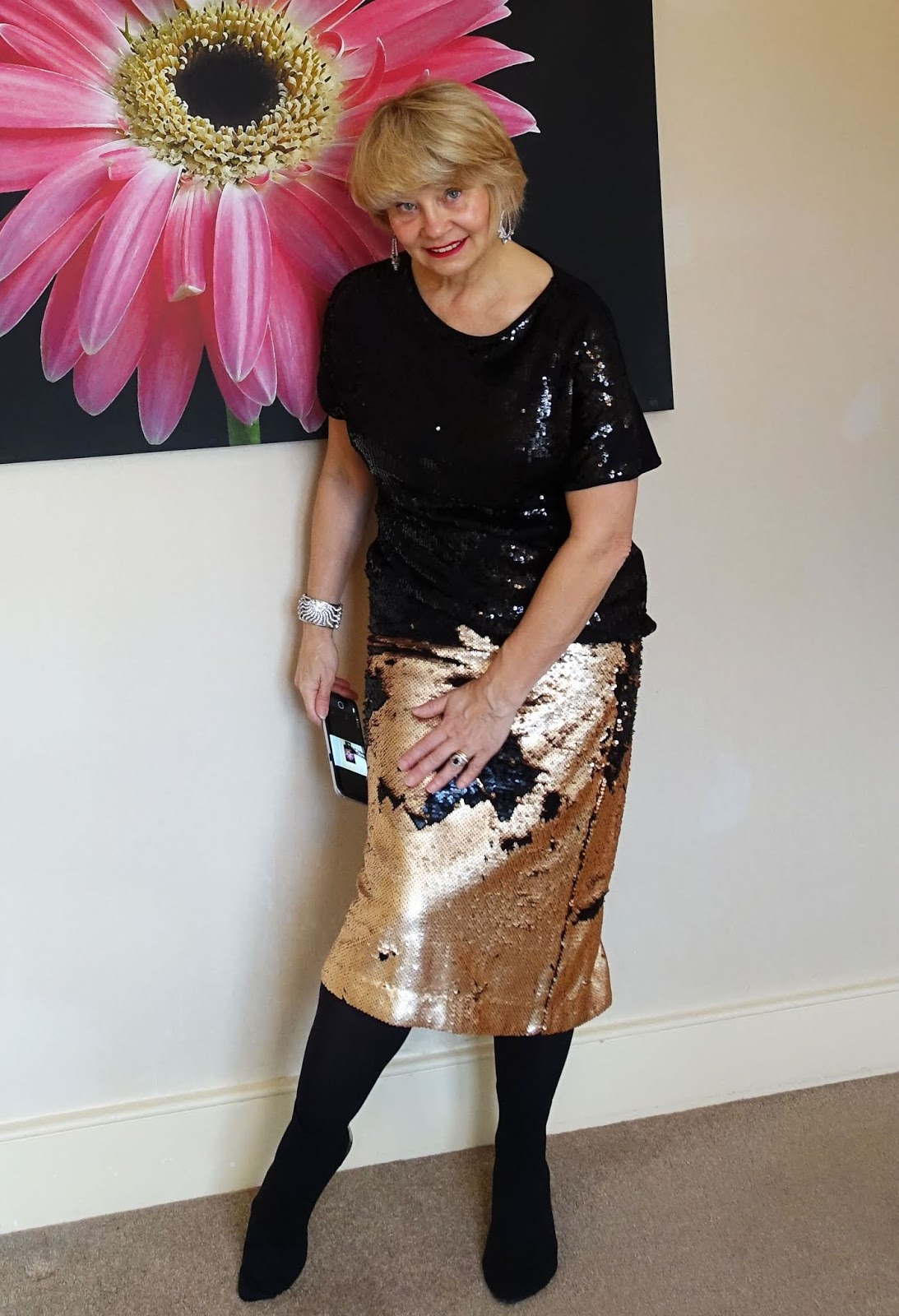How a sequin skirt can change colour: one side of the sequins is black and the other gold. As worn by over 50s blogger Is This Mutton.com