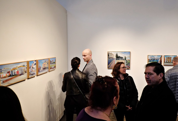 Art patrons view work. Kevin McKay, So Bondi at Brenda May GalleryStreet Fashion Sydney - Photographed by Kent Johnson.