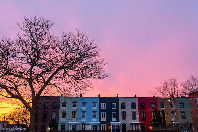 Portland, Maine USA February 2021 photo by Corey Templeton. A fiery sunrise above the row houses of Stratton Place.
