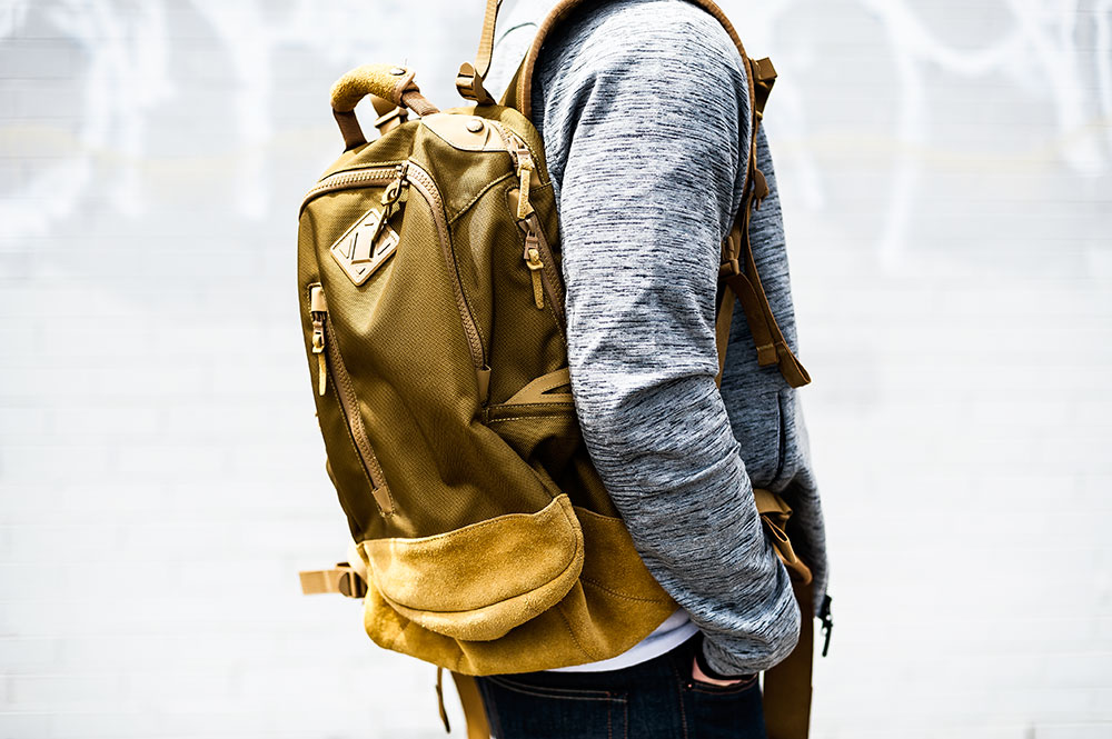 Nike Sportswear Heather Grey Tech Knit 2.0 / Visvim Ballistic 20L 'Mustard' Backpack by Tom Cunningham