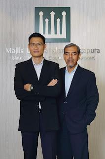 Source: Muis. Esa (left) with Hj Abdul  Razak (right).