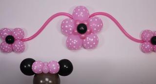 Luftballondekoration mit Minnie Maus als Thema.