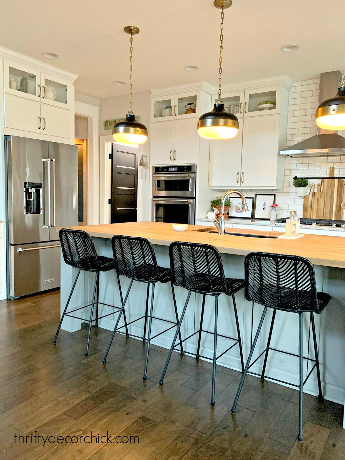 white kitchen gray island black doors