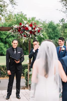 groom crying as bride walks into ceremony